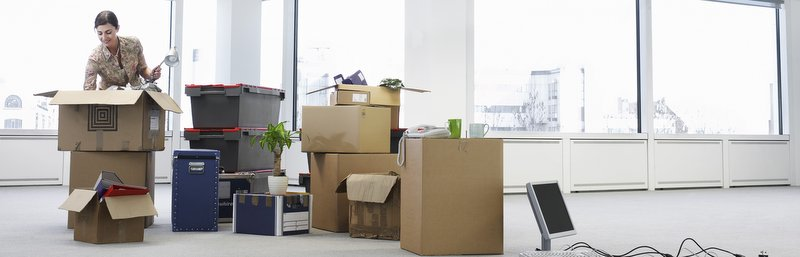woman unpacking an office